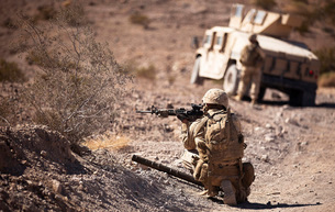 U.S. Marine scans his area while on patrol.の写真素材 [FYI02691684]