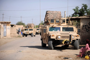 Humvee's conduct security during a patrol in the village ofの写真素材 [FYI02691765]