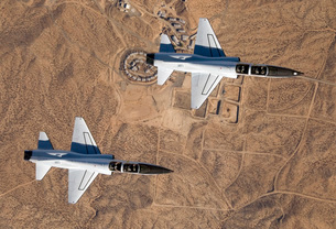 Two T-38A mission support aircraft fly in tight formation.の写真素材 [FYI02691768]