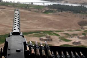A .50-caliber machine gun mounted on a CH-46 Sea Knight.の写真素材 [FYI02691811]