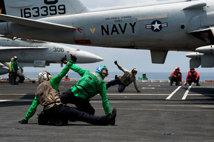 Sailors give launch approval for an EA-6B Prowler aboard USSの写真素材 [FYI02691866]