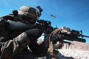 A grenadier provides suppressing fire during counter-ambushの写真素材 [FYI02691882]