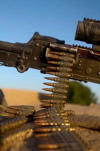 Rounds of a M240 machine gun over a compound roof.の写真素材 [FYI02692131]