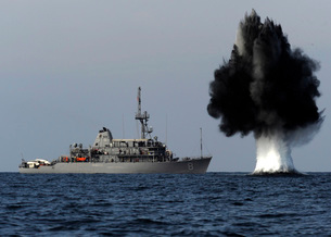 A demolition charge detonates 1,500 meters in front of USS Sの写真素材 [FYI02692155]