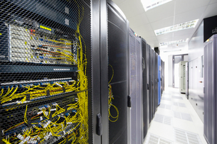 Server cabinet in data centre hallの写真素材 [FYI02692347]