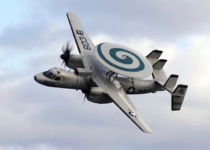 An E-2C Hawkeye performs a fly-by during an air power demonsの写真素材 [FYI02692480]