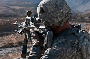 U.S. Army sniper scans a village in Afghanistan for Talibanの写真素材 [FYI02692830]