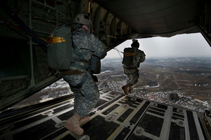 Soldiers jump from a C-130 aircraft over Germany.の写真素材 [FYI02692834]