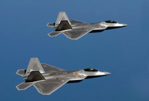 F-22A Raptors fly over Langley Air Force Base, Virginia.の写真素材 [FYI02692861]