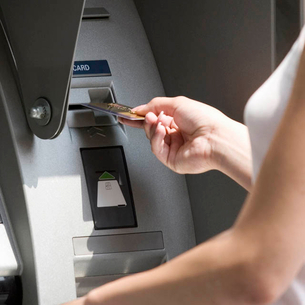 A young woman using a cash machineの写真素材 [FYI02692879]