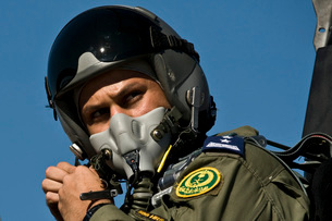 A Saudi Air Force pilot adjusts his flight helmet before a mission.の写真素材 [FYI02692951]
