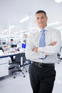 Businessman On Factory Floor Of Electronics Factoryの写真素材 [FYI02693184]