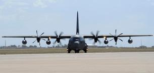 A MC-130J Combat Shadow II taxis on the flight line.の写真素材 [FYI02693264]