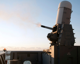 A close-in weapons system fires a burst of tungsten rounds.の写真素材 [FYI02693271]