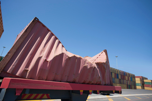 Damaged cargo container at commercial dockの写真素材 [FYI02693300]