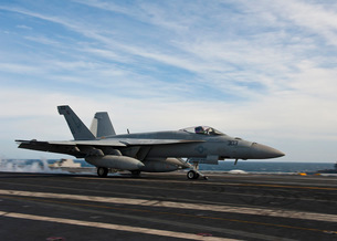 An F/A-18F Super Hornet takes off from the flight deck of USの写真素材 [FYI02693388]
