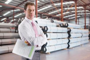 Businessman In Steel Store Of Engineering Factoryの写真素材 [FYI02693470]