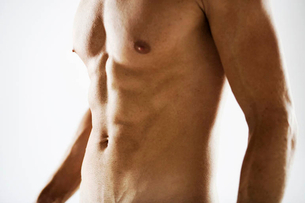 A male nude, mid sectionの写真素材 [FYI02693522]