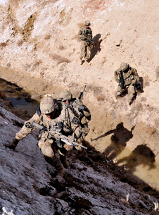 Soldiers approach a suspected weapons cache in Afghanistan.の写真素材 [FYI02693682]