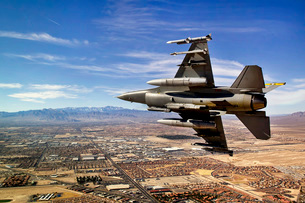 A fighter jet breaks right on a final approach over northernの写真素材 [FYI02693733]