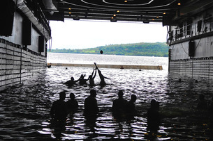 Sailors play football during a swim call in the well deck ofの写真素材 [FYI02693809]