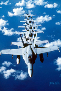 F/A-18C Hornet aircraft fly in formation during Operation Deの写真素材 [FYI02693865]
