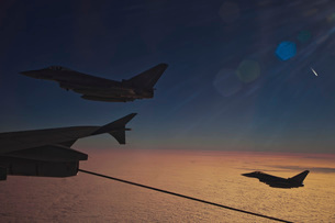 German Air Force Eurofighter Typhoon aircraft refueling over France.の写真素材 [FYI02693874]