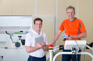 Portrait of sports scientist and runner on treadmill in laboratoryの写真素材 [FYI02693995]