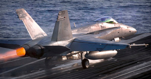 An F/A-18C Hornet launches from the Nimitz-class aircraft caの写真素材 [FYI02694077]