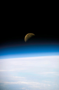 A quarter moon is visible in this oblique view of Earth's hoの写真素材 [FYI02694116]