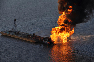 A natural gas pipeline burns after being struck by the tugboの写真素材 [FYI02694124]