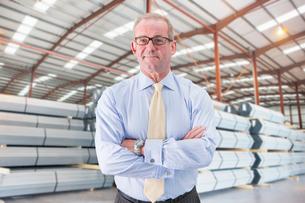 Businessman In Steel Store Of Engineering Factoryの写真素材 [FYI02694134]