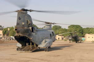 A CH-46 Sea Knight and Mi-8 helicopter at Al Kut, Iraq.の写真素材 [FYI02694136]