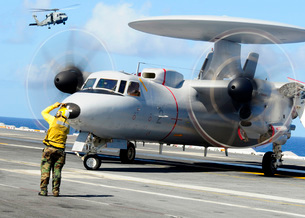An Aviation Boatswain's Mate directs a French E-2C Hawkeye aの写真素材 [FYI02694371]
