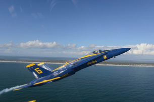 An F/A-18 Hornet from the Blue Angels during a training flight.の写真素材 [FYI02694631]