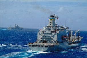 Amphibious assault ship USS Essex steams near USNS Walter S.の写真素材 [FYI02694647]
