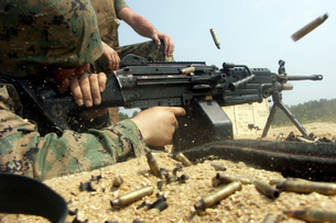 A Marine engages targets with an M-249 Squad Automatic Weapoの写真素材 [FYI02694696]
