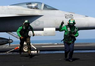 Aviation Boatswain Mate's signal a clear flight deck aboard USS John C. Stennis.の写真素材 [FYI02694780]