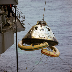 The Apollo 9 Command Module is hoisted aboard the recovery ship.の写真素材 [FYI02694926]