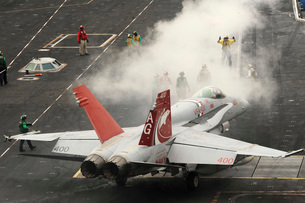 An F/A-18C Hornet prepares to launch from the flight deck of USS Dwight D. Eisenhower.の写真素材 [FYI02695147]
