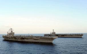 Nimitz-class aircraft carriers transit the Arabian Sea.の写真素材 [FYI02695226]