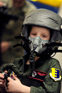 A young boy wears a helmet with oxygen mask attached.の写真素材 [FYI02695443]