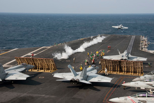 An F/A-18 Hornet launches from the aircraft carrier USS George Washington.の写真素材 [FYI02695674]