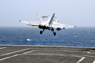 Two F/A-18C Hornet strike fighters launch from the aircraft carrier USS Ronald Reagan.の写真素材 [FYI02695680]