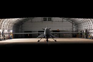 An MQ-1C Sky Warrior UAV parked in a hangar.の写真素材 [FYI02695986]