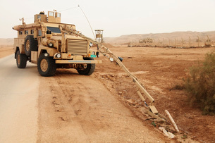 A MRAP vehicle disassembles an improvised explosive device.の写真素材 [FYI02696084]