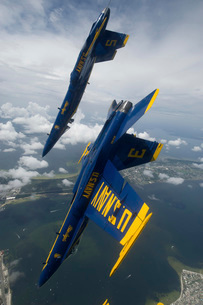 The Blue Angels perform a looping maneuver over Pensacola Beach, Florida.の写真素材 [FYI02696131]