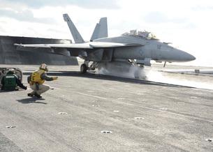 An F/A-18F Super Hornet launches off the flight deck of USS Enterprise.の写真素材 [FYI02696230]