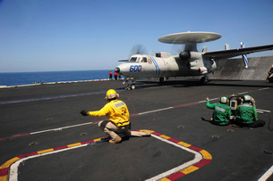 An E-2C Hawkeye launches from the flight deck of USS Dwight D. Eisenhower.の写真素材 [FYI02696232]