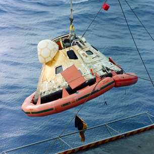The Apollo 8 capsule being hoisted aboard the recovery carrier.の写真素材 [FYI02696235]